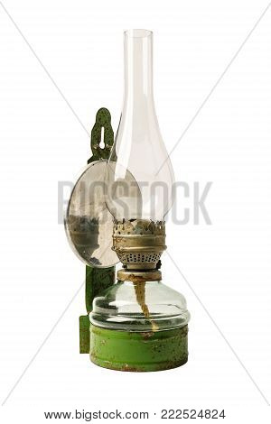 Old antique kerosene oil lantern lamp with  vintage glass chimney over fuel container isolated on white