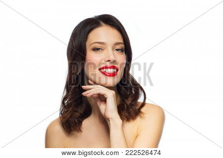 beauty, make up and people concept - happy smiling young woman with red lipstick posing over white background