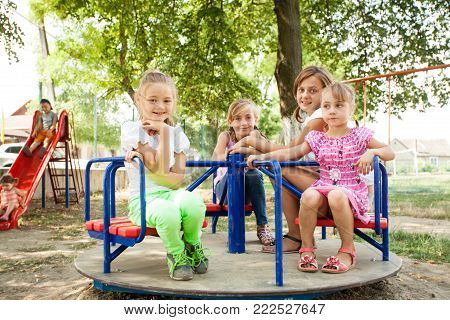 Kids on playground in the sunny summer day