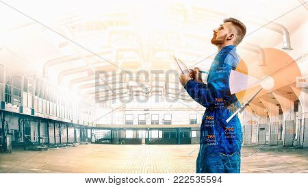 Portrait of a maneger with schedule on factory background