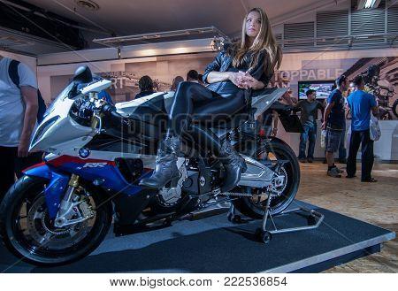 TEL-AVIV, ISRAEL - APRIL 1, 2010:  Promotion girl posing on BMW motor bike at Tel-Aviv Motor Show