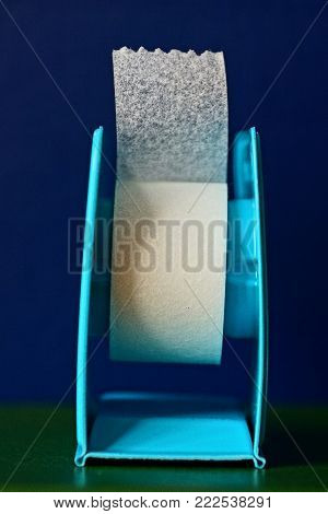White Plaster On The Blue Coil On The Table