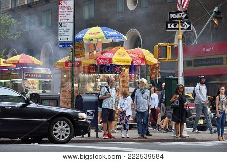 NEW YORK CITY - AUG. 28: Unidentified people on the Times Square in Manhattan on August 28, 2017 in New York City, NY. Times Square is a major tourist destination and entertainment center.
