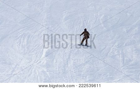 snowboarder rides . In the park in nature