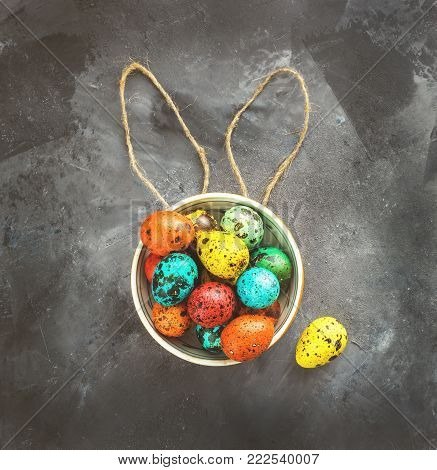 Easter colored eggs on a dark background, chalk, ears, Easter concept, inscription, text