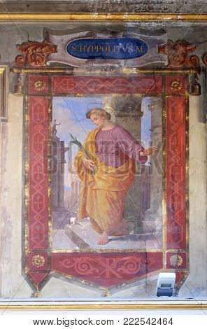 ROME, ITALY - SEPTEMBER 03: Saint Hippolytus martyr fresco painting in Church of St Lawrence at Lucina, Rome, Italy on September 03, 2016.