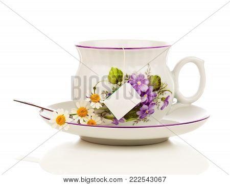 cup of camomile tea isolated on white background