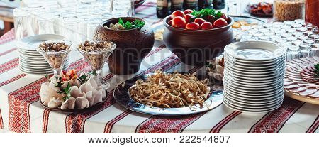 Hearty lard with garlic served with fresh bread on a table. saute tomatoes