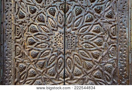 Ornaments of the bronze-plate ornate door of minbar (platform) al Sultan Hasan public mosque, Old Cairo, Egypt