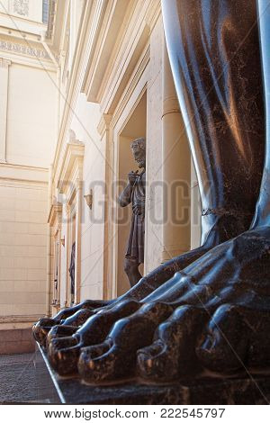 Feet of Atlantis on portico of the New Hermitage, decorated with sculptures - one of the main architectural langmark of Saint Petersburg