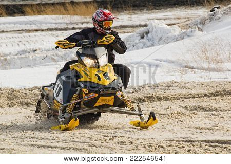 Tyumen, Russia - March 08. 2008: IV stage of personal-team Championship of Ural Federal district in over-snow cross-country. Snowmobile on bend of sport track