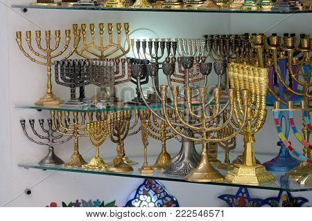 Hanukkah golden menorahs at showcase in souvenir store, Old City of Jerusalem. poster