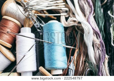 Sewing accessories - threads, needles, pins, yarn. Sewing Studio.