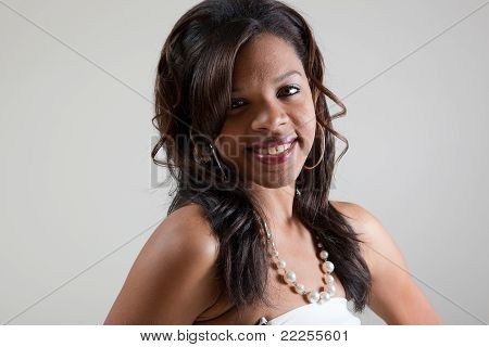 Head Shot of attractive black woman in pearls