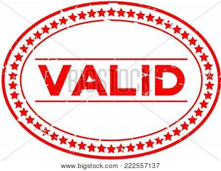 Grunge red valid word oval rubber seal stamp on white background