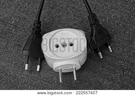 White Socket Adapter And Two Electrical Plugs On The Table