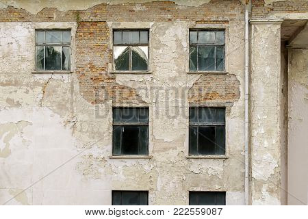 abandoned grunge cracked stucco wall with with window