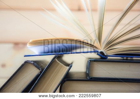 Book Stacking. Open Book, Hardback Books On White Background. Back To School. Copy Space For Text Bo
