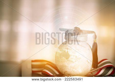 Graduate study abroad concept, Graduation cap on top Earth globe model  Australia map Radar background with Medals on laptop. Graduate study abroad program,Back to School Studies lead success in world