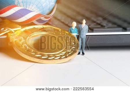 Miniature figurine with Medals Awards for winner of competition, Honor students studying or testing exams in leading universities, school, Competitions and Education study concepts