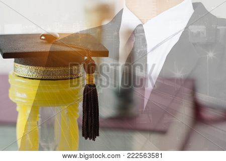 Graduate study international abroad concept, Graduation cap on yellow hourglass with blur Blur Businessman. Graduate study abroad program for students foreign county, Study abroad lead to success