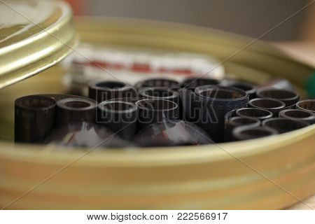 film archive negatives in a round metal can