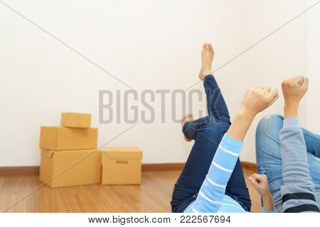 Couple chilling in empty room that ready to move in - buying new house concept.