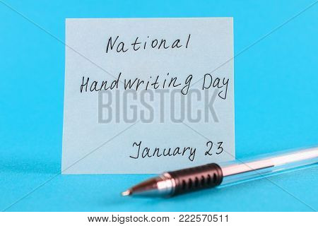 A note with an inscription is a national day of hand writing and a pen