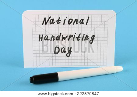 A note with an inscription is a national day of hand writing and a marker