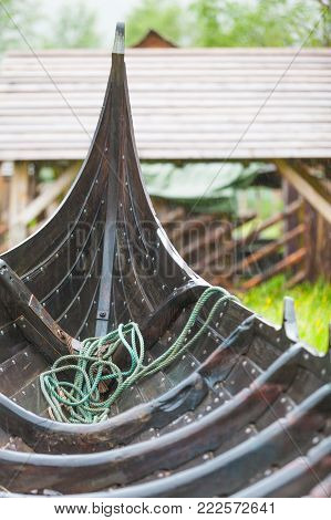 Part of old wooden viking boat in norwegian nature. Tourism and traveling concept