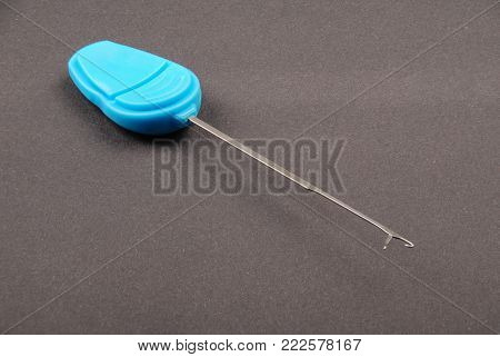 One blue splicing needle isolated on black background