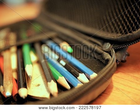 Colored Pencils and Art Supplies in Pencil Case