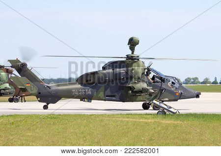 BERLIN, GERMANY - MAY 21, 2014: German Army EC665 Tiger attack helicopter flying display at the International Aerospace Exhibition ILA in Berlin, Germany.