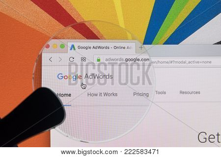 Sankt-Petersburg ,Russia, January 11, 2018: Google Adwords homepage website on Apple iMac monitor screen under a magnifying glass. Google AdWords is online advertising service.