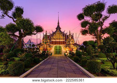 Bangkok , Thailand - 15 January, 2018: giant statues at white pagoda in Wat Arun Ratchawararam Ratchawaramahawihan in sunset time