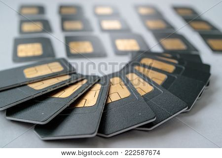 SIM cards are laid out like a fan in the background of the card is gray