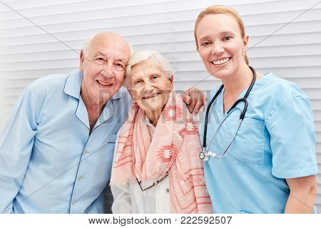 Nurse and happy senior couple in hospital or nursing home
