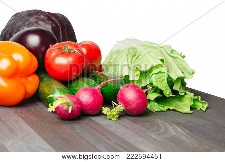 Vegetables on a table isolated on a white background .Fresh vegetables. Colorful vegetable . Healthy vegetable . Assortment of fresh vegetables .Healthy food .