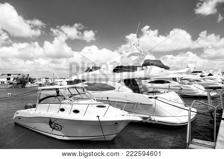 La Romana, Dominican Republic - February 16, 2016: luxury yachts docked in the port in bay at sunny day with clouds on blue sky in La Romana, Dominican Republic