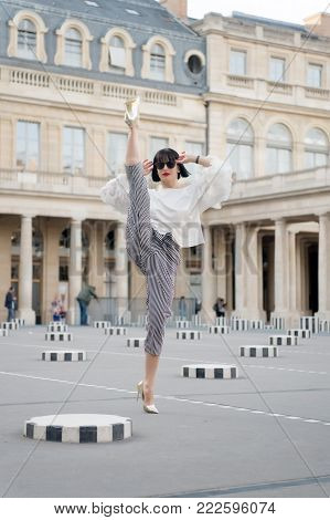 Model In Fashionable Clothes On Street Of Paris, France