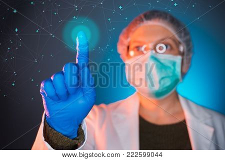 Healthcare worker using modern innovative technology in medicine, female doctor working on virtual screen