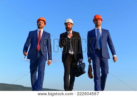 Coworking And Construction Business Concept. Foremen Present Teamwork.