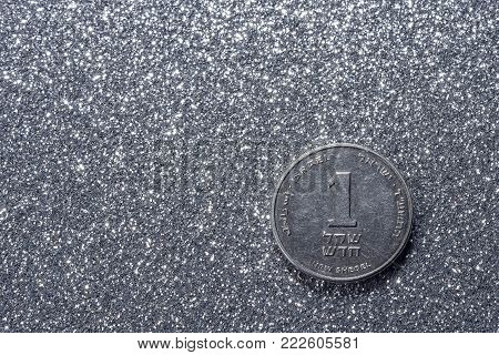 one Israeli New Sheqel. One shekel on a silvery background.