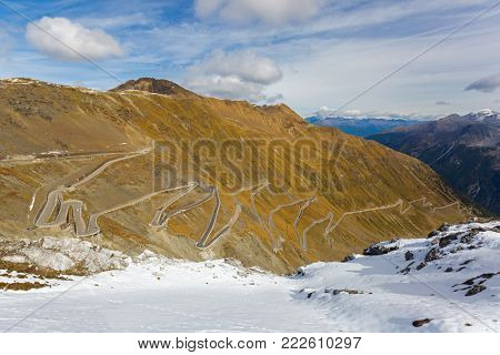 Hairpin turns of mountain pass (Stelvio Pass) named Stilfser Joch in Deutsch, in Italy during Autumn