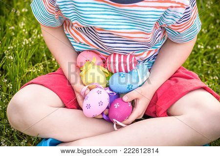 Cute Smiling Boy Holding Basket With Colorful Eggs After Easter Egg Hunt