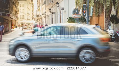 VALENCIA, SPAIN - June 16, 2017 : car is driving fast on a pedestrian crossing near a pedestrian zone on a summer day