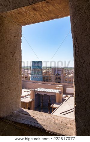 Unfinished turquoise-tiled Kalta Minor Minaret at Ichan Qala, view from a window - Khiva, Uzbekistan poster