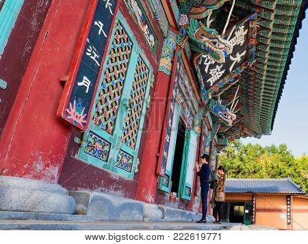 busan, south korea, 8th november 2017, buddhist worshippers at the beautiful haedong yonggungsa temple
