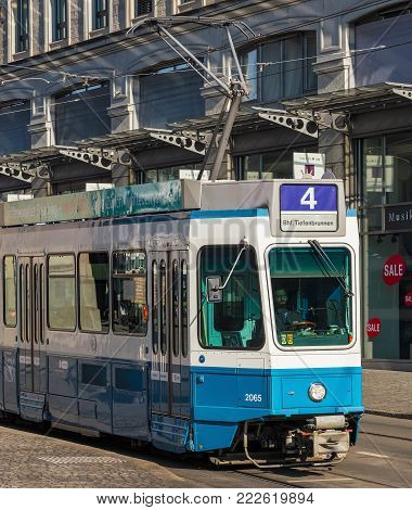 Zurich, Switzerland - 29 January, 2017: a tram passing along the Limmatquai quay. Trams have been a consistent part of Zurich's cityscape since the 1880s, when the first horse-drawn tram ran, electrified from the 1890s.