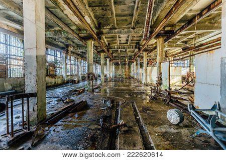 Old abandoned workshop of abandoned submarine torpedo factory.